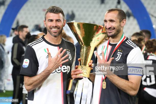 Andrea Barzagli and Giorgio Chiellini with the trophy of Scudetto during the victory ceremony following the Italian Serie A last football match of...