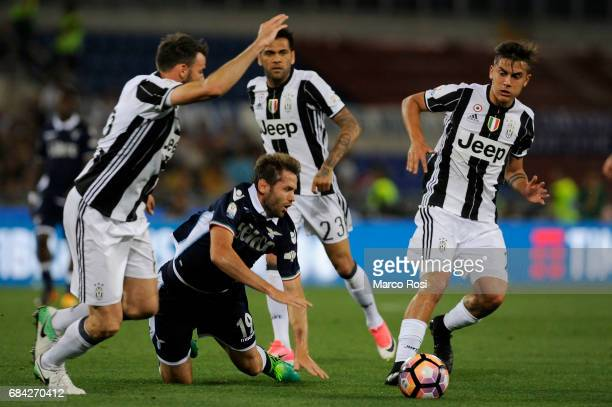 Andrea Barzagli and Paulo Dybala compete for the ball with Senad Lulic of SS lazio during the TIM Cup Final match between SS Lazio and Juventus FC at...