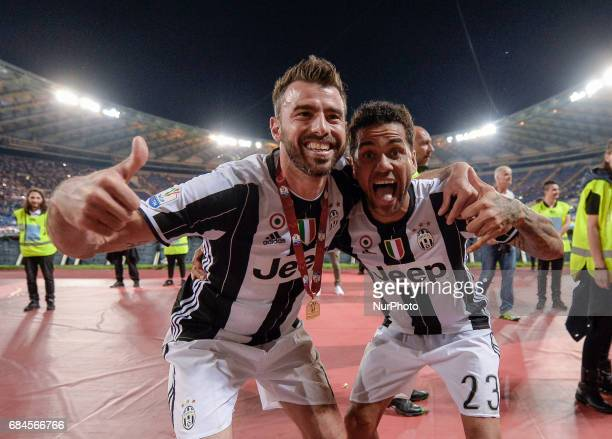 Andrea Barzagli Dani Alves celebrates after winning the TIM Cup Final match against SS Lazio during the Tim Cup football match FC Juventus vs SS...