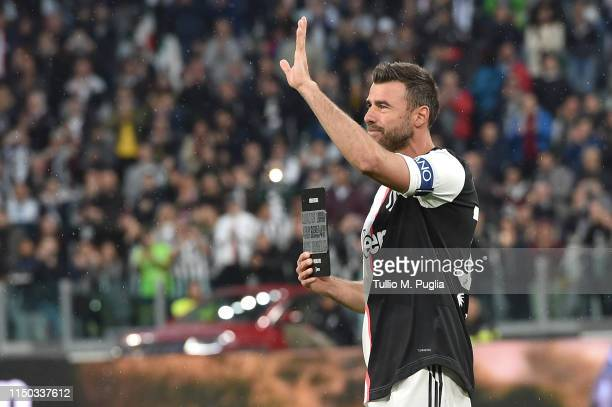 Andrea Barzagli is awarded a plaque in recognition of his career during the Serie A match between Juventus and Atalanta BC on May 19 2019 in Turin...