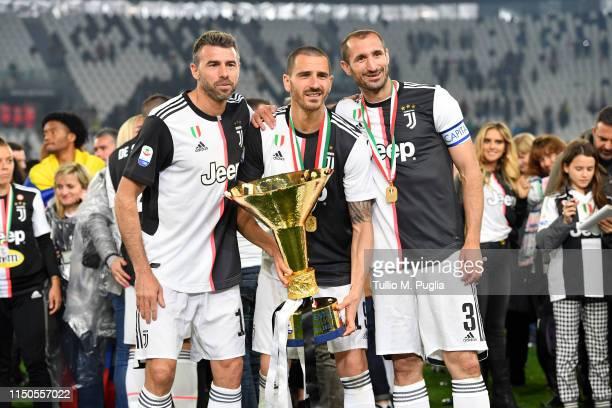 Andrea Barzagli, Leonardo Bonucci and Giorgio Chiellini of Juventus celebrate during the awards ceremony after winning the Serie A Championship...