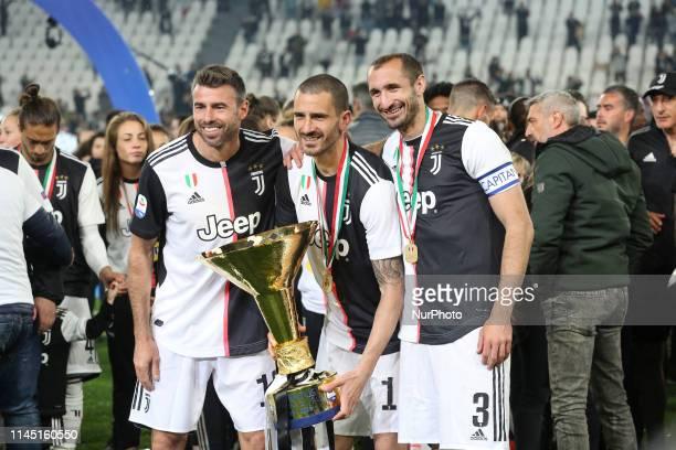 Andrea Barzagli Leonardo Bonucci and Giorgio Chiellini with the trophy of Scudetto during the victory ceremony following the Italian Serie A last...