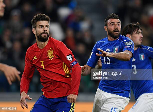 Andrea Barzagli of Italy and Gerard Pique of Spain compete during the FIFA 2018 World Cup Qualifier between Italy and Spain at Juventus Stadium on...