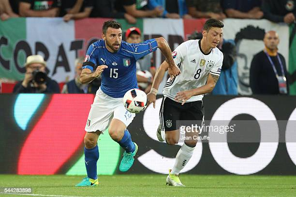Andrea Barzagli of Italy and Mesut Oezil of Germany in action during the UEFA Euro 2016 quarter final match between Germany and Italy at Stade Matmut...