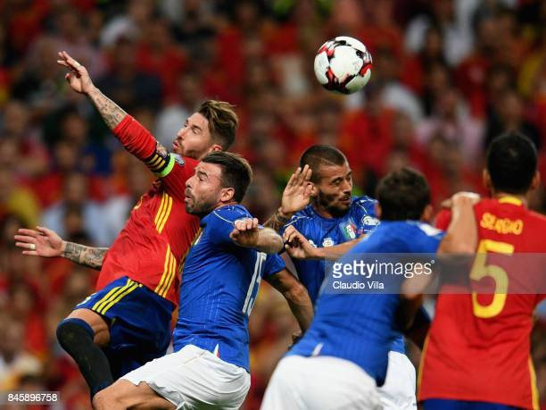 Andrea Barzagli of Italy and Sergio Ramos of Spain compete for the ball during the FIFA 2018 World Cup Qualifier between Spain and Italy at Estadio...