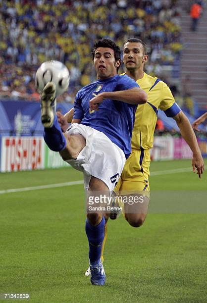 Andrea Barzagli of Italy clears the ball as Andriy Shevchenko of the Ukraine closes in during the FIFA World Cup Germany 2006 Quarterfinal match...
