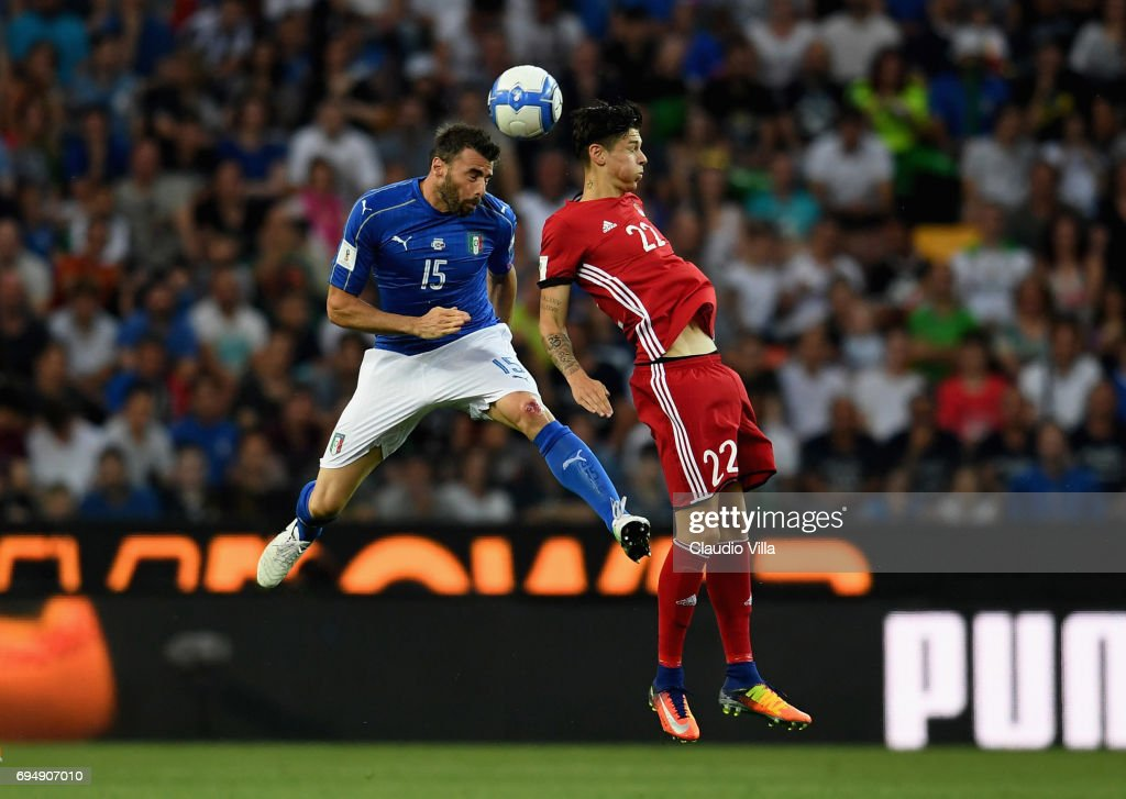 Andrea Barzagli of Italy (L) competes for the ball with Mario Frick of Liechtenstein during the FIFA 2018 World Cup Qualifier between Italy and Liechtenstein at Stadio Friuli on June 11, 2017 in Udine.