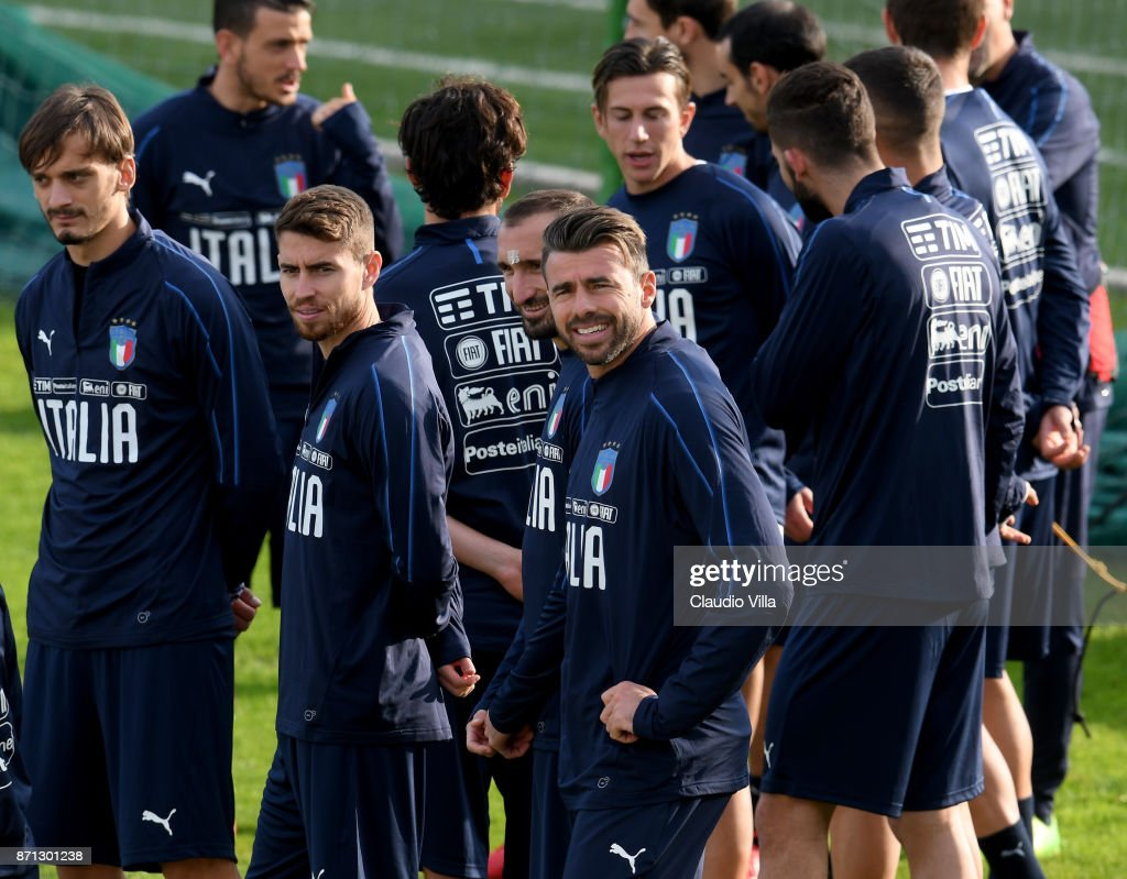 Andrea Barzagli of Italy (R) looks on during the training session at Italy club's training ground at Coverciano on November 7, 2017 in Florence, Italy.