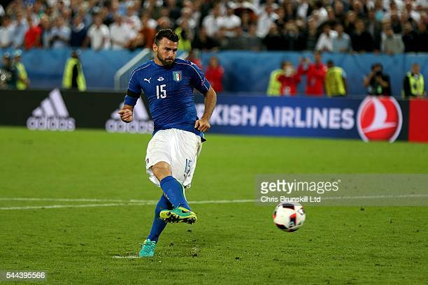 Andrea Barzagli of Italy scores during the penalty shoot out following the UEFA Euro 2016 Quarter Final match between Germany and Italy at Nouveau...