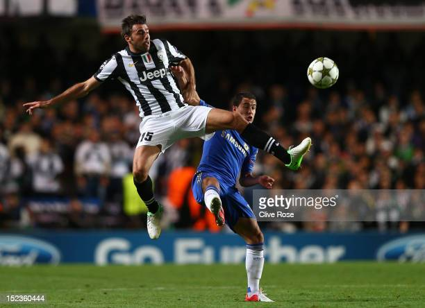 Andrea Barzagli of Juventus and Eden Hazard of Chelsea compete for the ball during the UEFA Champions League Group E match between Chelsea and...