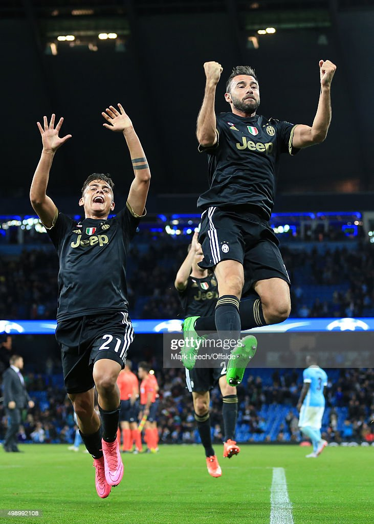Andrea Barzagli of Juventus (R) and teammate Paulo Dybala celebrate victory following the UEFA Champions League Group D match between Manchester City and Juventus on September 15, 2015 in Manchester, England.