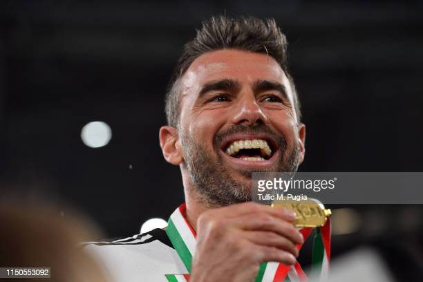 Andrea Barzagli of Juventus celebrates during the awards ceremony after winning the Serie A Championship during the Serie A match between Juventus...
