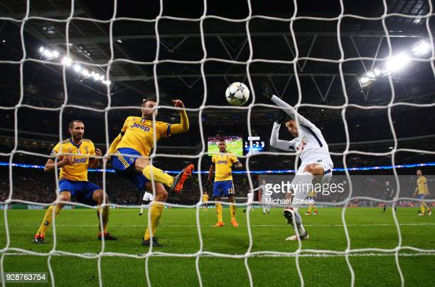 Andrea Barzagli of Juventus clears the ball from the goal line under pressure from Erik Lamela of Tottenham Hotspur during the UEFA Champions League...