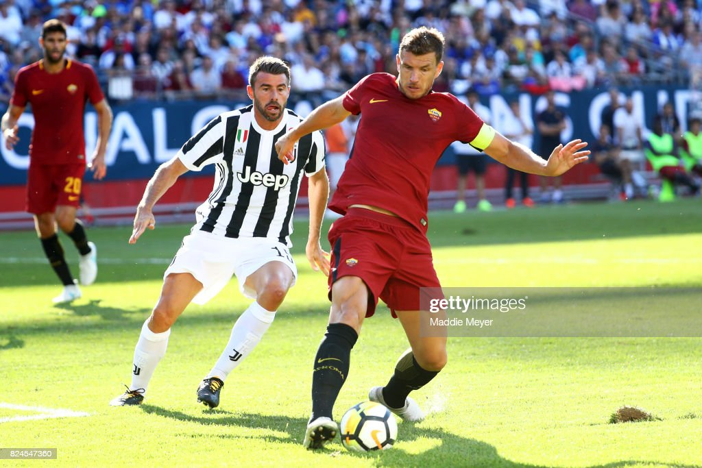 Andrea Barzagli #15 of Juventus defends Edin Dzeko #9 of Roma during the International Champions Cup 2017 match at Gillette Stadium on July 30, 2017 in Foxboro, Massachusetts.