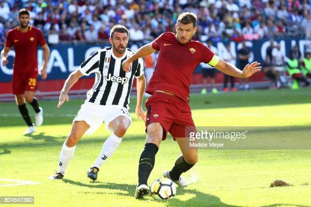 Andrea Barzagli of Juventus defends Edin Dzeko of Roma during the International Champions Cup 2017 match at Gillette Stadium on July 30 2017 in...