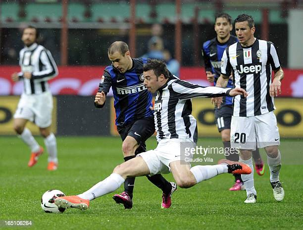 Andrea Barzagli of Juventus FC and Rodrigo Palacio of FC Inter Milan compete for the ball during the Serie A match between FC Internazionale Milano...