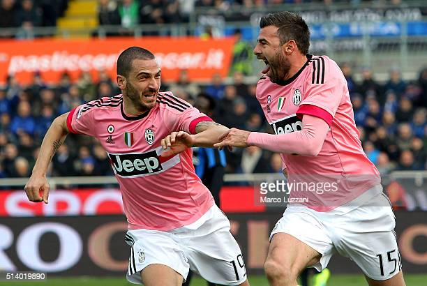 Andrea Barzagli of Juventus FC celebrates with his teammate Leonardo Bonucci after scoring the opening goal during the Serie A match between Atalanta...