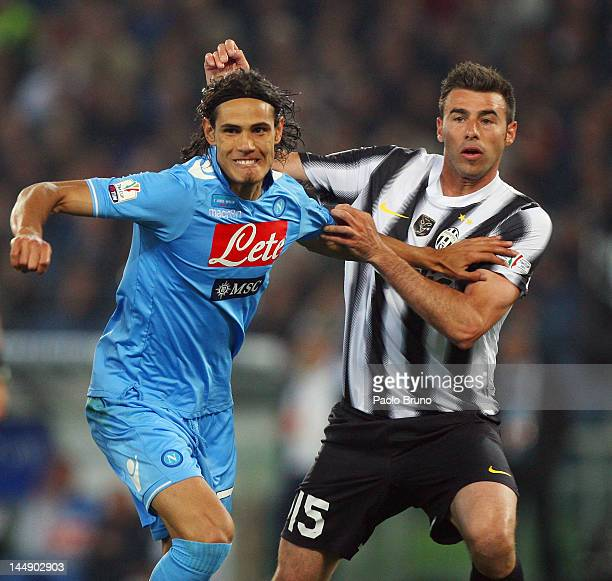 Andrea Barzagli of Juventus FC competes for the ball with Edinson Cavani of SSC Napoli during the Tim Cup final match between Juventus FC and SSC...