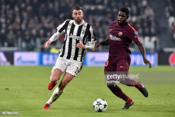 Andrea Barzagli of Juventus is challenged by Samuel Umtiti of Barcelona during the UEFA Champions League match between Juventus and Barcelona at the...
