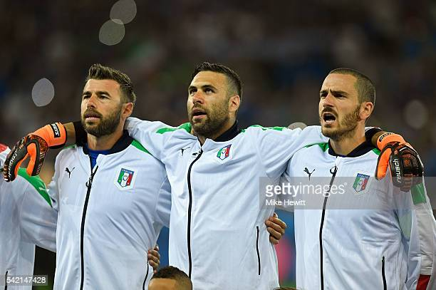 Andrea Barzagli Salvatore Sirigu and Leonardo Bonucci of Italy line up for the national anthem prior to the UEFA EURO 2016 Group E match between...