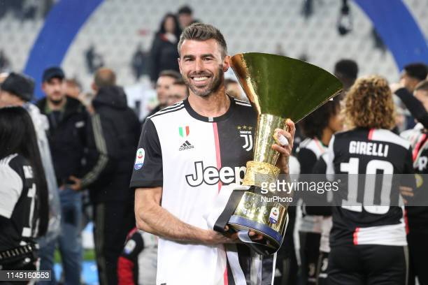 Andrea Barzagli with the trophy of Scudetto during the victory ceremony following the Italian Serie A last football match of the season Juventus...