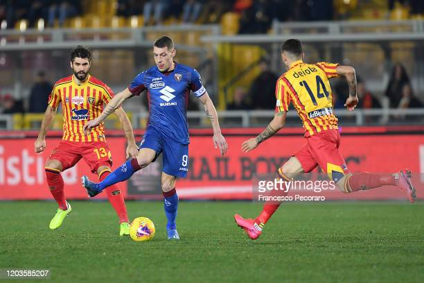 Andrea Bellotti of Torino FC vies with Alessandro Deiola of US Lecce during the Serie A match between US Lecce and Torino FC at Stadio Via del Mare...