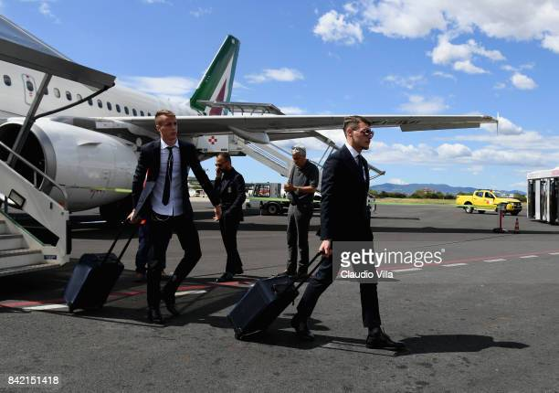 Andrea Belotti and Andrea Conti of Italy arrive at Florence Airport on September 3 2017 in Florence Italy