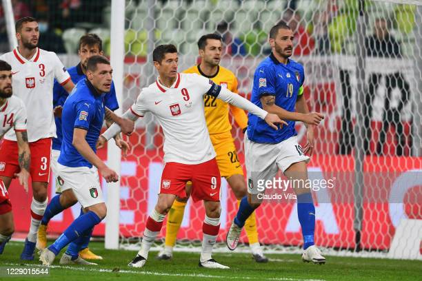 Andrea Belotti and Leonardo Bonucci of Italy competes for the ball with Robert Lewandowski of Poland during the UEFA Nations League group stage match...