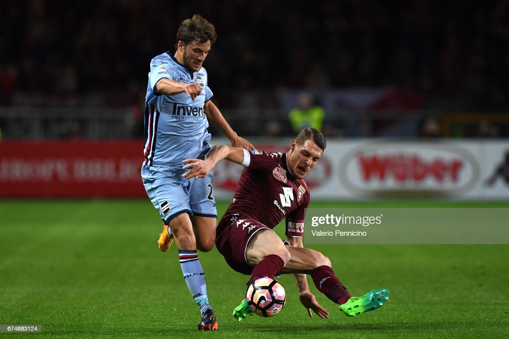 Andrea Belotti (R) of FC Torino competes with Bartosz Bereszynski of UC Sampdoria during the Serie A match between FC Torino and UC Sampdoria at Stadio Olimpico di Torino on April 29, 2017 in Turin, Italy.