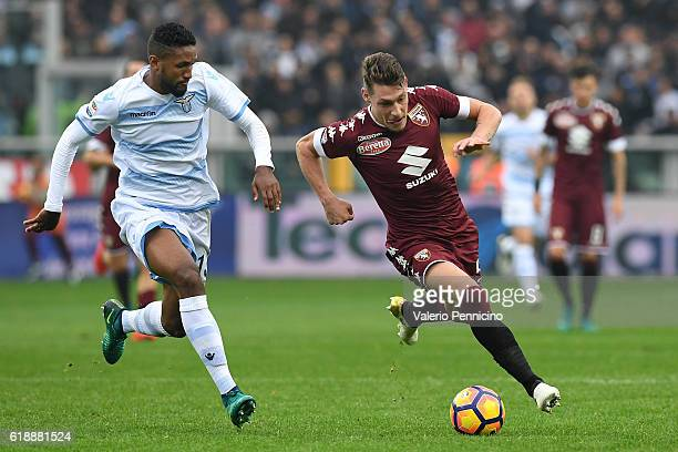 Andrea Belotti of FC Torino is challenged by Fortuna Dos Santos Wallace of SS Lazio during the Serie A match between FC Torino and SS Lazio at Stadio...