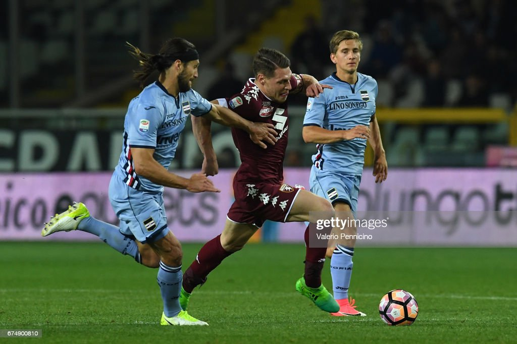 Andrea Belotti (C) of FC Torino is challenged by Matias Agustin Silvestre (L) of UC Sampdoria during the Serie A match between FC Torino and UC Sampdoria at Stadio Olimpico di Torino on April 29, 2017 in Turin, Italy.
