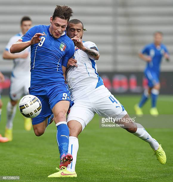 Andrea Belotti of Italy and Dionatan Teixeira of Slovakia in action during the UEFA U21 Championship Playoff second leg match between Italy and...