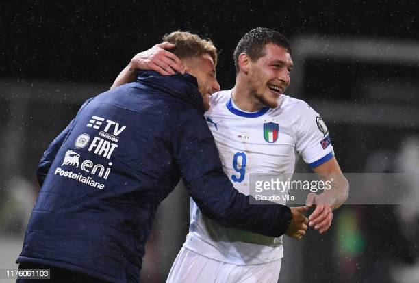 Andrea Belotti of Italy celebrates with Ciro Immobile of Italy after scoring the second goal during the UEFA Euro 2020 qualifier between...