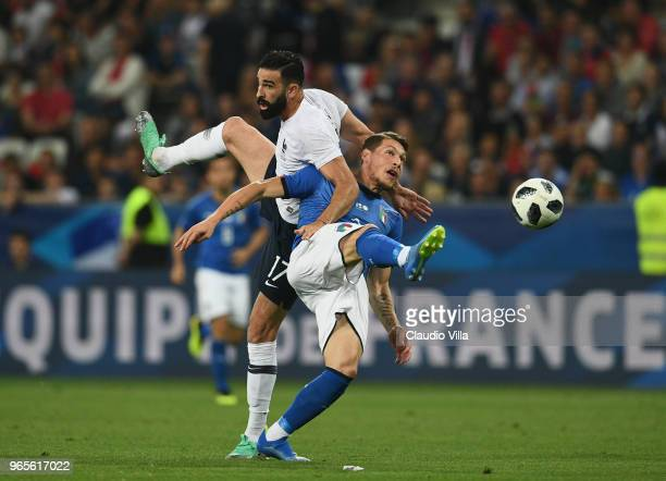 Andrea Belotti of Italy competes for the ball with Adil Rami of France during the International Friendly match between France and Italy at Allianz...