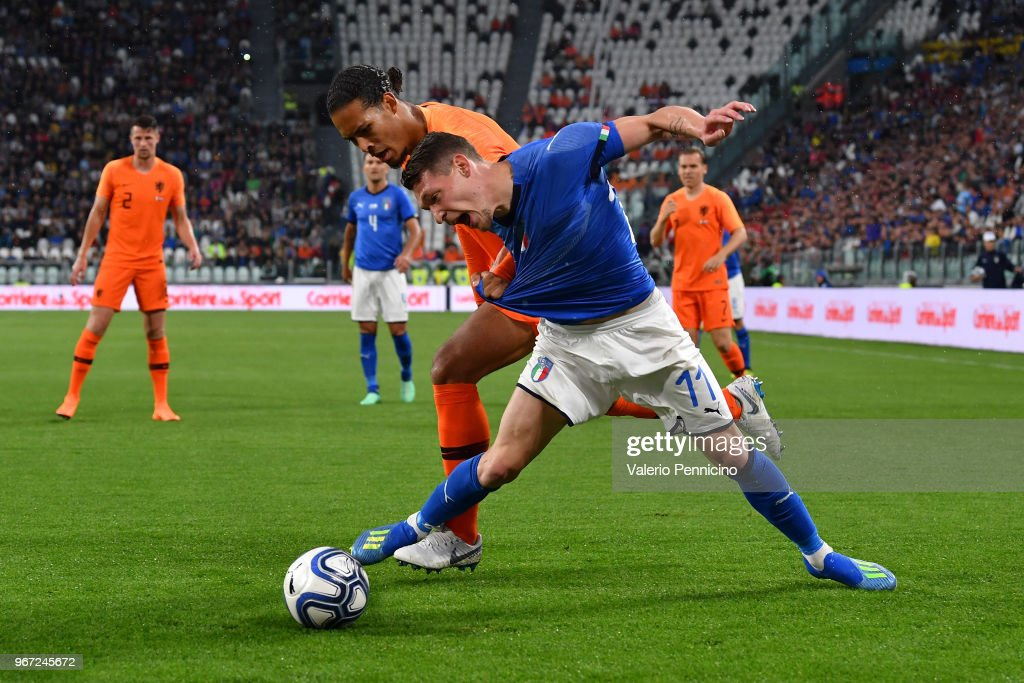 Andrea Belotti of Italy competes for the ball with Virgil van Dijk of Netherlands during the International Friendly match between Italy and Netherlands at Allianz Stadium on June 4, 2018 in Turin, Italy.