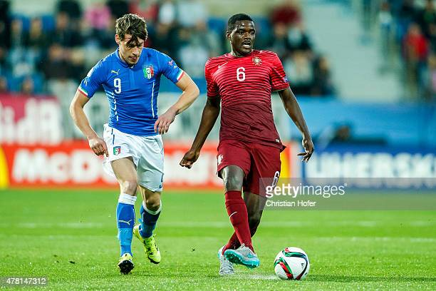 Andrea Belotti of Italy competes for the ball with William Carvalho of Portugal during the UEFA Under21 European Championship 2015 match between...