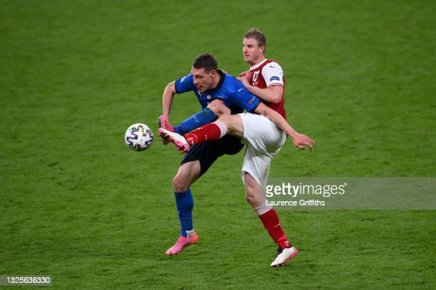 Andrea Belotti of Italy is challenged by Martin Hinteregger of Austria during the UEFA Euro 2020 Championship Round of 16 match between Italy and...