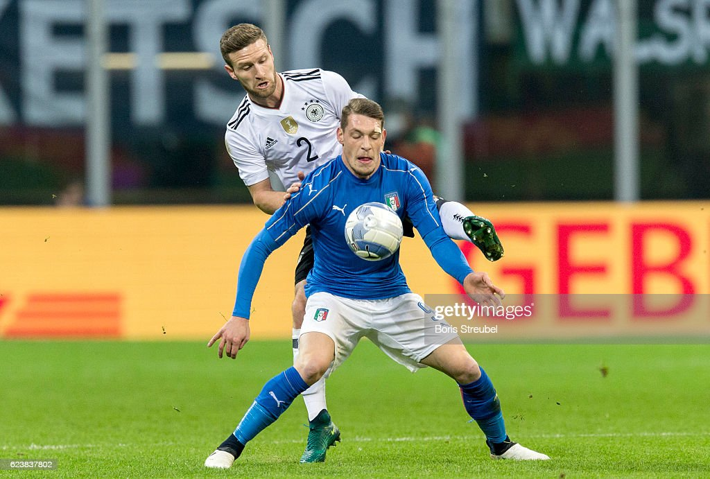 Andrea Belotti of Italy is challenged by Shkodran Mustafi of Germany during the International Friendly Match between Italy and Germany at Giuseppe Meazza Stadium on November 15, 2016 in Milan, .
