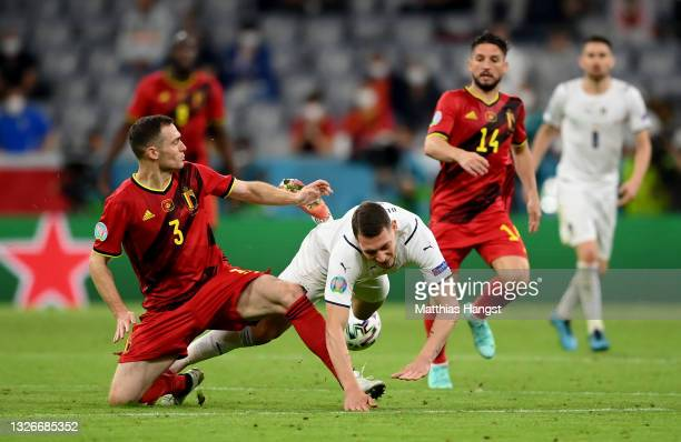 Andrea Belotti of Italy is challenged by Thomas Vermaelen of Belgium during the UEFA Euro 2020 Championship Quarter-final match between Belgium and...