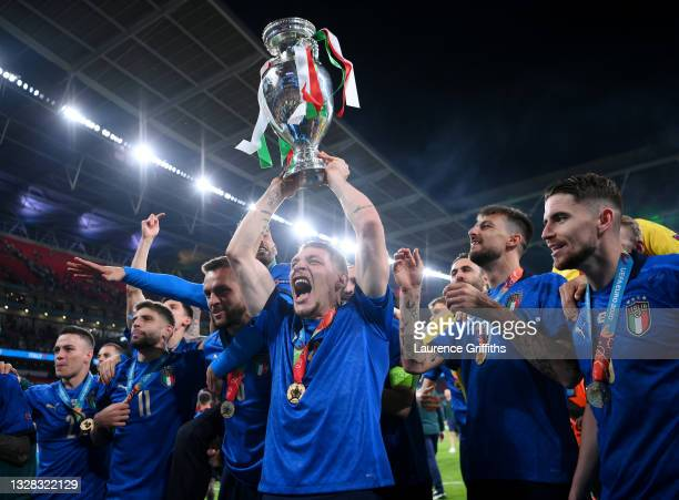 Andrea Belotti of Italy of Italy celebrates with the European Championship Trophy whilst celebrating with the fans during the UEFA Euro 2020...