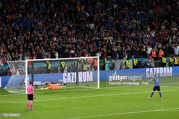 Andrea Belotti of Italy scores his team's second penalty in a penalty shoot out past Unai Simon of Spain during the UEFA Euro 2020 Championship...