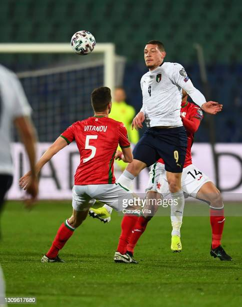 Andrea Belotti of Itlay competes for the ball with Petar Vitanov and Daniel Dimov of Bulgaria during the FIFA World Cup 2022 Qatar qualifying match...