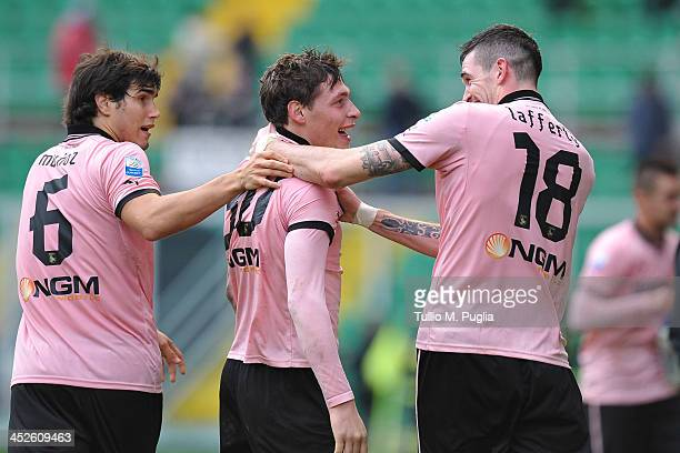 Andrea Belotti of Palermo celebrates with teanmates Ezequiel Munoz and Kyle Lafferty after scoring the opening goal during the Serie B match between...