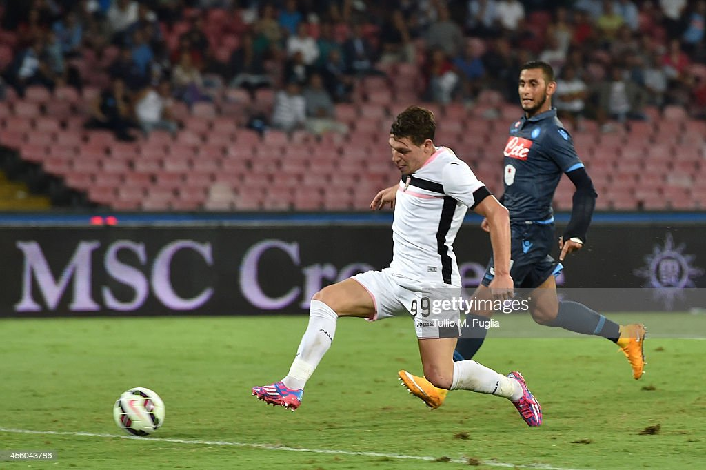 Andrea Belotti of Palermo scores the second equalizing goal (3-3) during the Serie A match between SSC Napoli and US Citta di Palermo at Stadio San Paolo on September 24, 2014 in Naples, Italy.