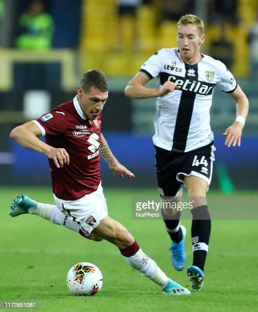Andrea Belotti of Torino and Dejan Kulusevski of Parma during the Serie A match Parma Calcio v Torino Fc at the Ennio Tardini Stadium in Parma Italy...