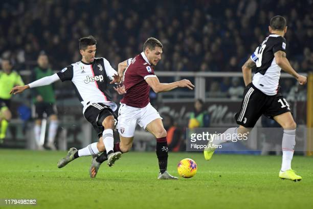 Andrea Belotti of Torino and Rodrigo Bentancur of Juventus fight for the ball during the Serie A match between Torino FC and Juventus at Stadio...