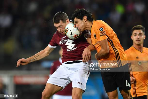 Andrea Belotti of Torino clasches with Jesus Vallejo of Wolverhampton Wanderers during the UEFA Europa League Playoffs 1st Leg match between Torino...