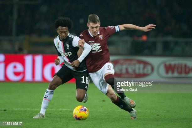 Andrea Belotti of Torino FC against Juan Cuadrado of Juventus FC during the Serie A match between Torino FC and Juventus at Stadio Olimpico di Torino...