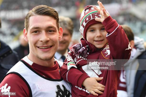 Andrea Belotti of Torino FC and a young Torino fan pose for a photo during the Serie A match between Torino FC and Udinese Calcio at Stadio Olimpico...