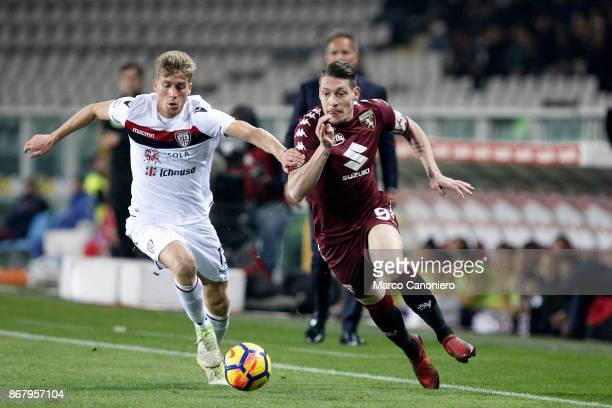 Andrea Belotti of Torino FC and Filippo Romagna of Cagliari Calcio in action during the Serie A football match between Torino Fc and Cagliari Calcio...